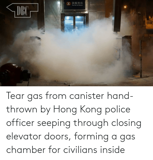 Civilians: 油麻地站  DEG  Yau Ma Tei Station  DBC Tear gas from canister hand-thrown by Hong Kong police officer seeping through closing elevator doors, forming a gas chamber for civilians inside