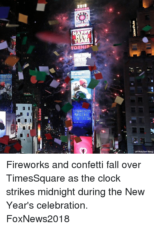 fall over: 20i8  TOSHIBA  (AP Photo/Seth Wenig) Fireworks and confetti fall over TimesSquare as the clock strikes midnight during the New Year's celebration. FoxNews2018