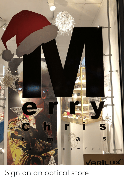 Versace: 307 N  EDACAKE  VERSACE  RSACE  N e  W Y e a  VARİLUX Sign on an optical store