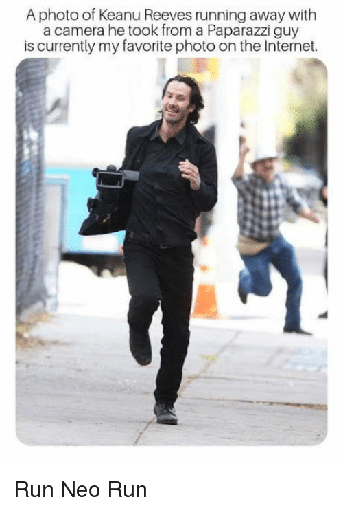 paparazzi: A photo of Keanu Reeves running away with  a camera he took from a Paparazzi guy  is currently my favorite photo on the Internet. Run Neo Run