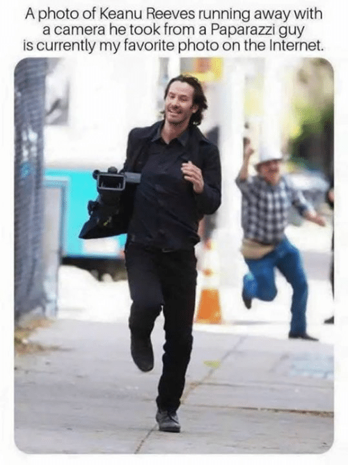 paparazzi: A photo of Keanu Reeves running away with  a camera he took from a Paparazzi guy  is currently my favorite photo on the Internet.