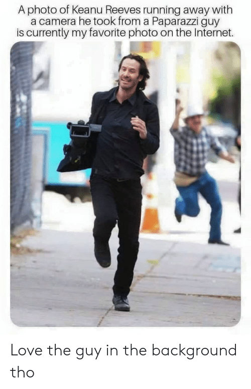 paparazzi: A photo of Keanu Reeves running away with  a camera he took from a Paparazzi guy  is currently my favorite photo on the Internet. Love the guy in the background tho