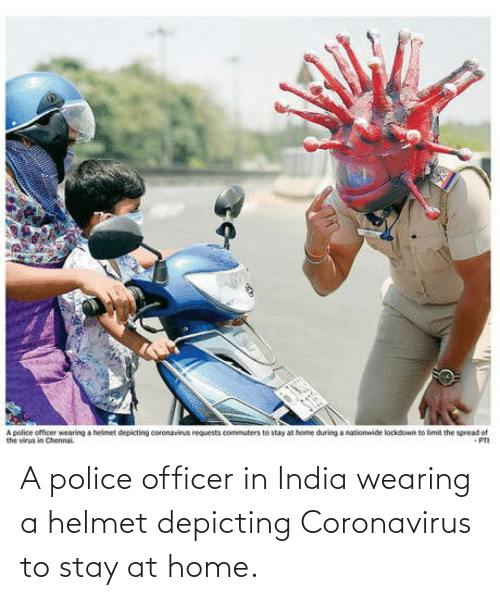 officer: A police officer in India wearing a helmet depicting Coronavirus to stay at home.