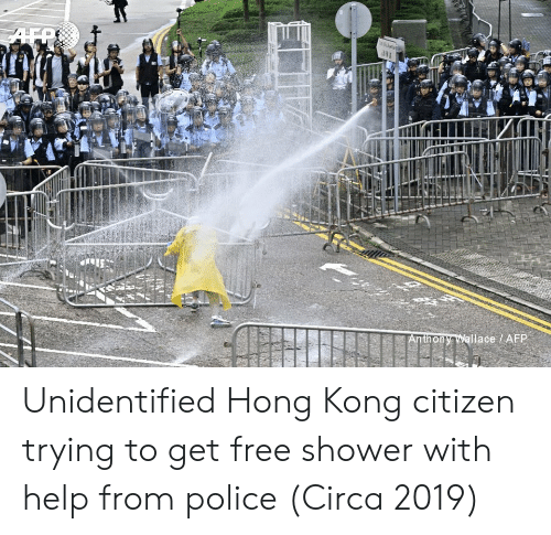 Police, Shower, and Free: AFR  Anthony Wallace / AFP Unidentified Hong Kong citizen trying to get free shower with help from police (Circa 2019)