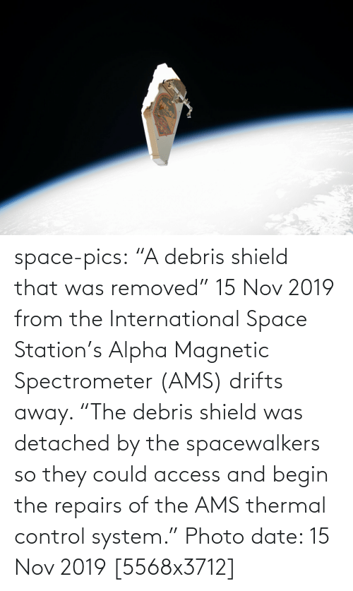 "alpha: AMS-02 space-pics:  ""A debris shield that was removed"" 15 Nov 2019 from the International Space Station's Alpha Magnetic Spectrometer (AMS) drifts away. ""The debris shield was detached by the spacewalkers so they could access and begin the repairs of the AMS thermal control system."" Photo date: 15 Nov 2019 [5568x3712]"