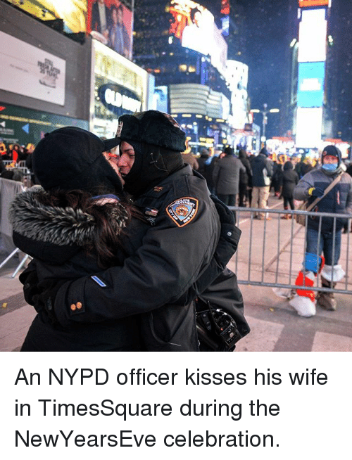 Newyearseve: An NYPD officer kisses his wife in TimesSquare during the NewYearsEve celebration.