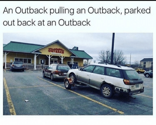 Outback: An Outback pulling an Outback, parked  out back at an Outback  OUTBACK