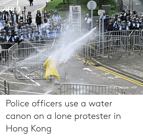Police, Canon, and Hong Kong: Anthony Wallace AFP Police officers use a water canon on a lone protester in Hong Kong