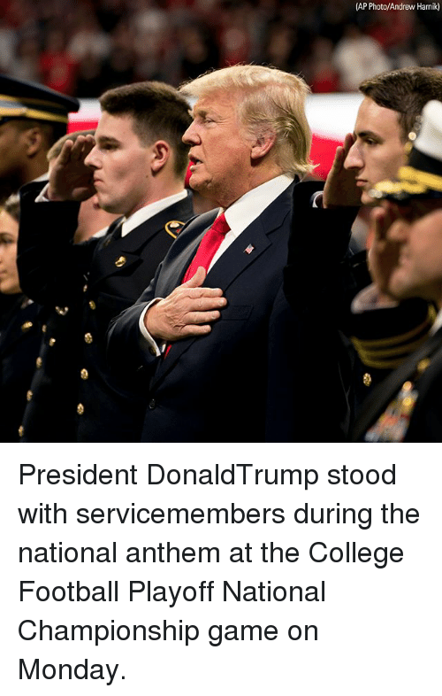 College football: (AP Photo/Andrew Harnik) President DonaldTrump stood with servicemembers during the national anthem at the College Football Playoff National Championship game on Monday.