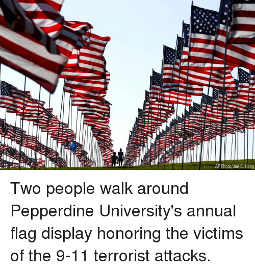 9/11, Memes, and 🤖: AP Photo/Jae C. Hong Two people walk around Pepperdine University's annual flag display honoring the victims of the 9-11 terrorist attacks.