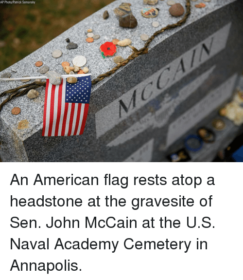 Memes, Academy, and American: AP Photo/Patrick Semansky An American flag rests atop a headstone at the gravesite of Sen. John McCain at the U.S. Naval Academy Cemetery in Annapolis.