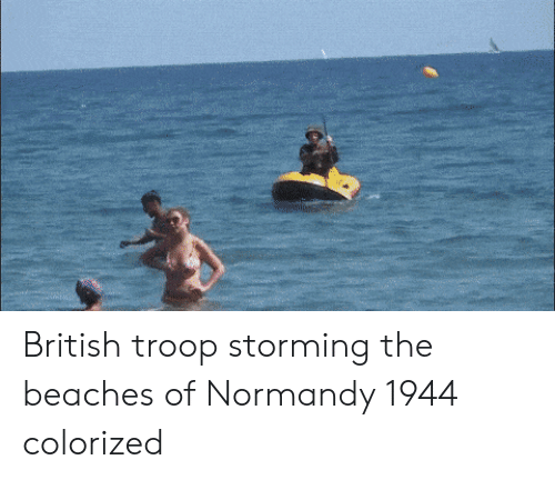 troop: British troop storming the beaches of Normandy 1944 colorized