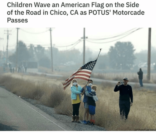 potus: Children Wave an American Flag on the Side  of the Road in Chico, CA as POTUS' Motorcade  Passes