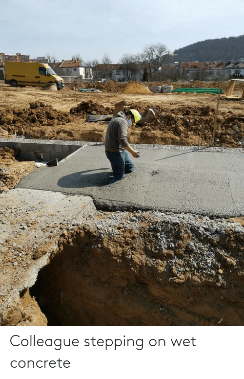 concrete: Colleague stepping on wet concrete