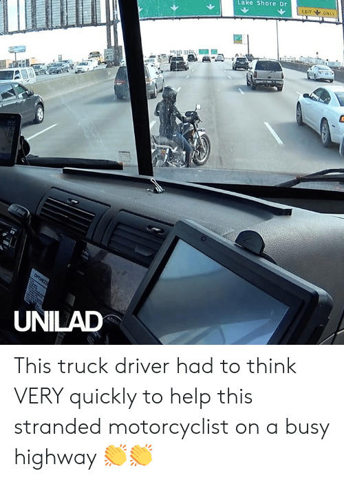 brake: EXIT ONLY  Lake Shore Dr  SPEE  45  BRAKE  OPTIMIZE  ADANG  UNILAD This truck driver had to think VERY quickly to help this stranded motorcyclist on a busy highway 👏👏