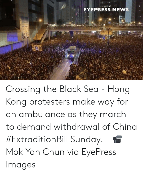 ambulance: EYEPRESS NEWS Crossing the Black Sea - Hong Kong protesters make way for an ambulance as they march to demand withdrawal of China #ExtraditionBill Sunday. - 📹 Mok Yan Chun via EyePress Images