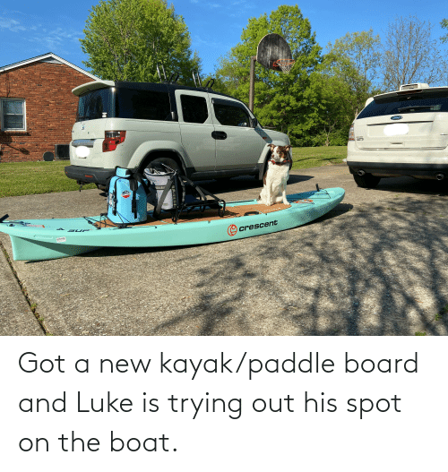 Kayak: Got a new kayak/paddle board and Luke is trying out his spot on the boat.