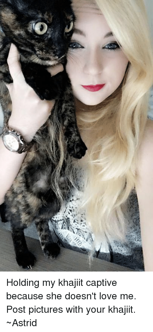 captivated: Holding my khajiit captive because she doesn't love me.  Post pictures with your khajiit.  ~Astrid
