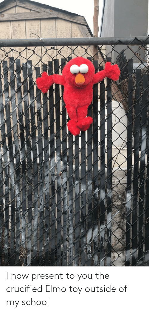 Outside Of: I now present to you the crucified Elmo toy outside of my school