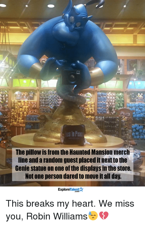 talent explore: In Peac  The pillow is from the Haunted Mansion merch  line and a random guest placed itnextto the  Genie statue on one of the displays in the store.  Not one person dared move it all day.  Talent  Explore This breaks my heart. We miss you, Robin Williams😓💔