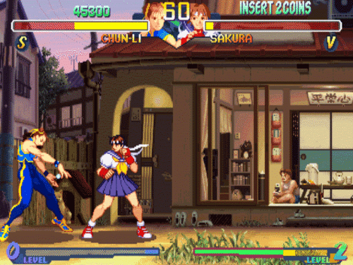 Chun-Li, Sakura, and Level: INSERT 2COINS  60  45300  SAKURA  CHUN-LI  V  LEVEL  JEVEL