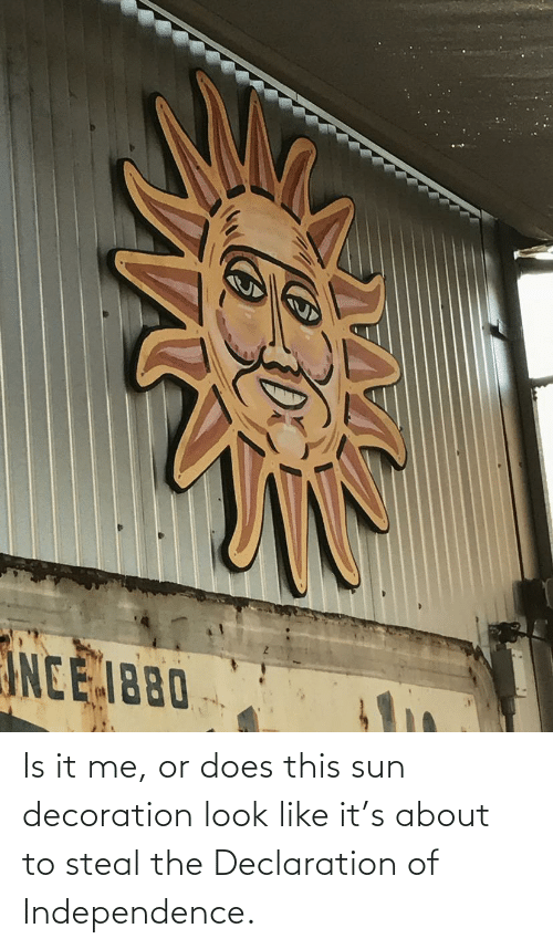 it-me: Is it me, or does this sun decoration look like it's about to steal the Declaration of Independence.