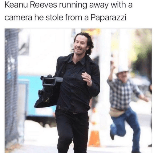 paparazzi: Keanu Reeves running away with a  camera he stole from a Paparazzi