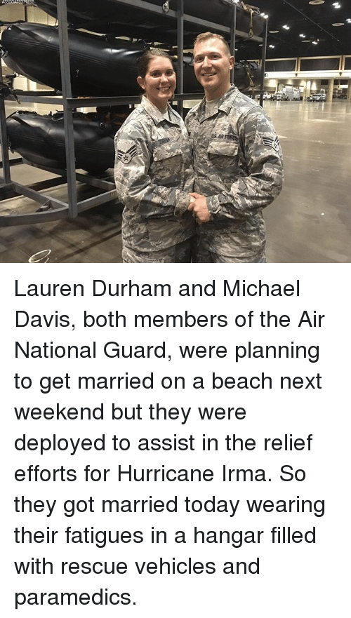 beached: Lauren Durham and Michael Davis, both members of the Air National Guard, were planning to get married on a beach next weekend but they were deployed to assist in the relief efforts for Hurricane Irma. So they got married today wearing their fatigues in a hangar filled with rescue vehicles and paramedics.
