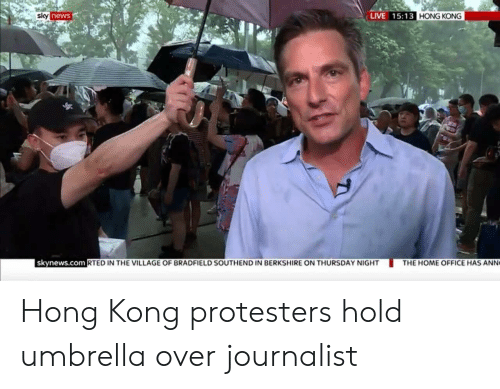 News, Home, and Hong Kong: LIVE 15:13 HONG KONG  sky news  skynews.com RTED IN THE VILLAGE OF BRADFIELD SOUTHEND IN BERKSHIRE ON THURSDAY NIGHT  THE HOME OFFICE HAS ANN Hong Kong protesters hold umbrella over journalist