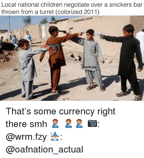 snickers: Local national children negotiate over a snickers bar  thrown from a turret (colorized 2011)  @oafnation actual  @wrm.fzy That's some currency right there smh 🤦🏽♂️ 🤦🏽♂️🤦🏽♂️ 📷: @wrm.fzy 🧙🏽♂️: @oafnation_actual