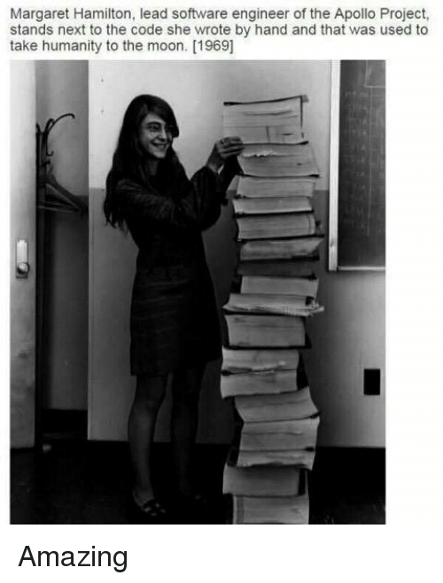 software engineering: Margaret Hamilton, lead software engineer of the Apollo Project,  stands next to the code she wrote by hand and that was used to  take humanity to the moon. [1969] Amazing