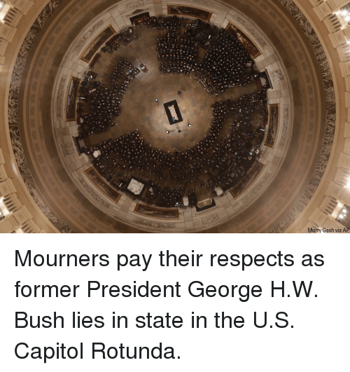 capitol: Morry Gash via AP Mourners pay their respects as former President George H.W. Bush lies in state in the U.S. Capitol Rotunda.