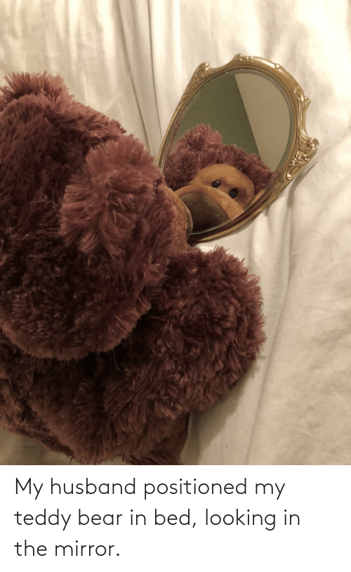 Looking In The Mirror: My husband positioned my teddy bear in bed, looking in the mirror.