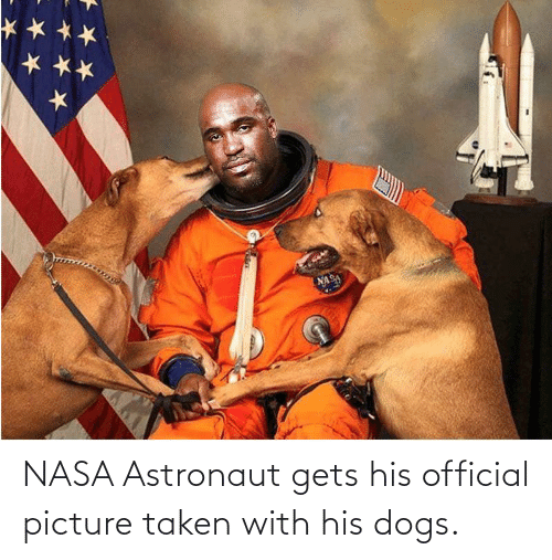 Taken: NASA Astronaut gets his official picture taken with his dogs.