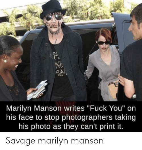"Print: NK  IN  Marilyn Manson writes ""Fuck You"" on  his face to stop photographers taking  his photo as they can't print it. Savage marilyn manson"