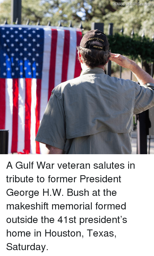 George H. W. Bush: oarm A Gulf War veteran salutes in tribute to former President George H.W. Bush at the makeshift memorial formed outside the 41st president's home in Houston, Texas, Saturday.