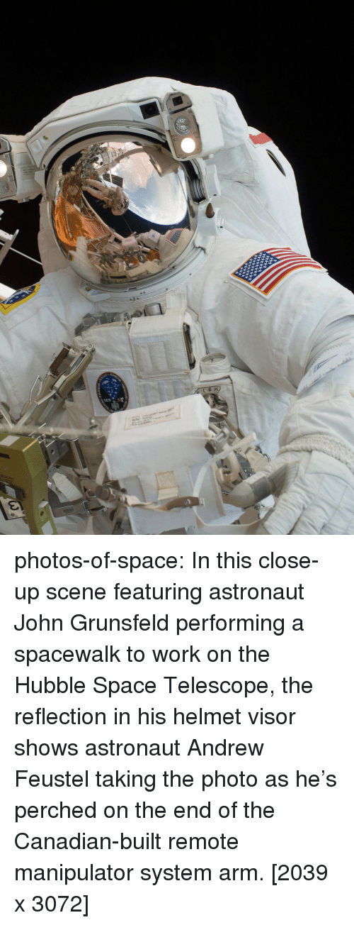 This Close: photos-of-space:  In this close-up scene featuring astronaut John Grunsfeld performing a spacewalk to work on the Hubble Space Telescope, the reflection in his helmet visor shows astronaut Andrew Feustel taking the photo as he's perched on the end of the Canadian-built remote manipulator system arm. [2039 x 3072]