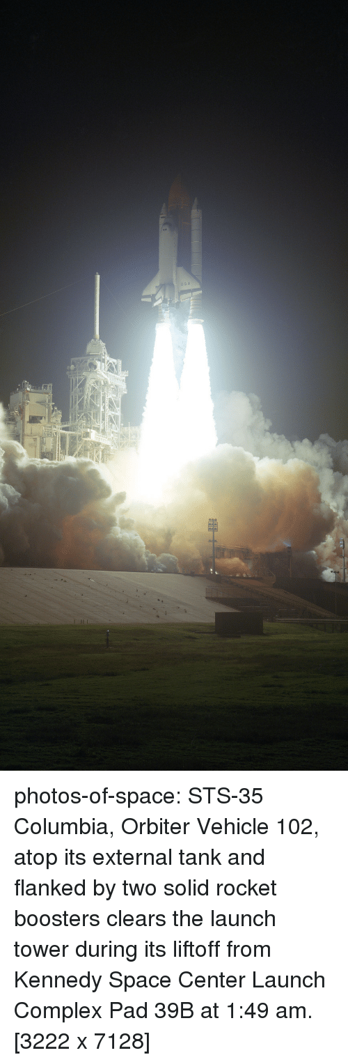Columbia: photos-of-space:  STS-35 Columbia, Orbiter Vehicle 102, atop its external tank and flanked by two solid rocket boosters clears the launch tower during its liftoff from Kennedy Space Center Launch Complex Pad 39B at 1:49 am.[3222 x 7128]