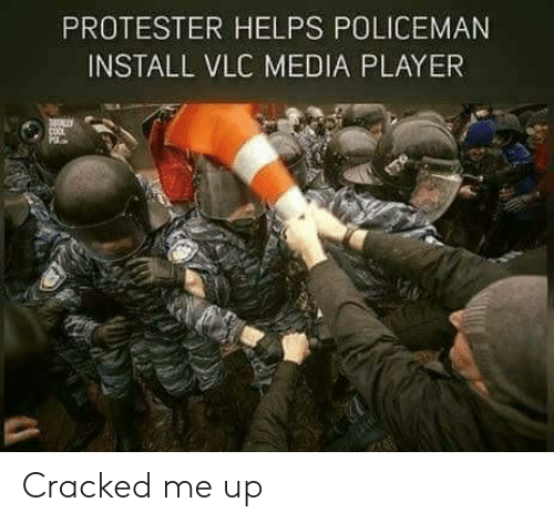 Protester: PROTESTER HELPS POLICEMAN  INSTALL VLC MEDIA PLAYER Cracked me up