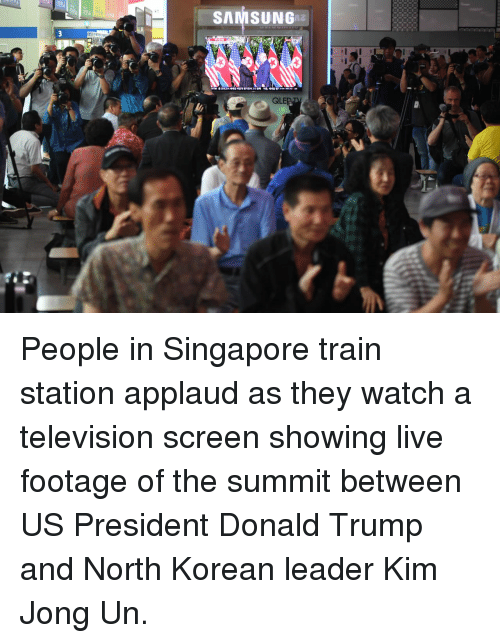 Donald Trump, Kim Jong-Un, and Live: SAMSUNGna  QLEP People in Singapore train station applaud as they watch a television screen showing live footage of the summit between US President Donald Trump and North Korean leader Kim Jong Un.
