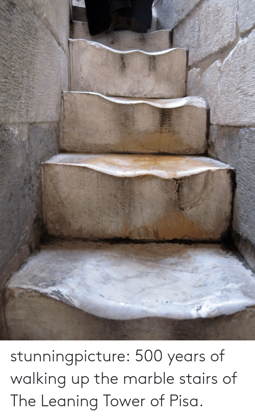 leaning tower: stunningpicture:  500 years of walking up the marble stairs of The Leaning Tower of Pisa.