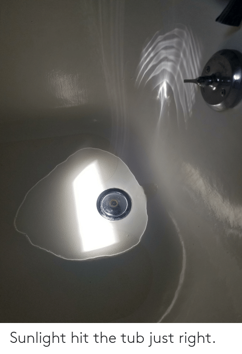 tub: Sunlight hit the tub just right.