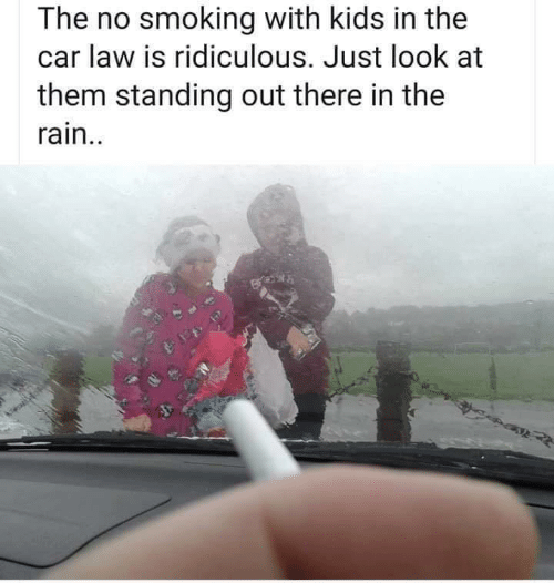 Smoking, Kids, and Rain: The no smoking with kids in the  car law is ridiculous. Just look at  them standing out there in the  rain..