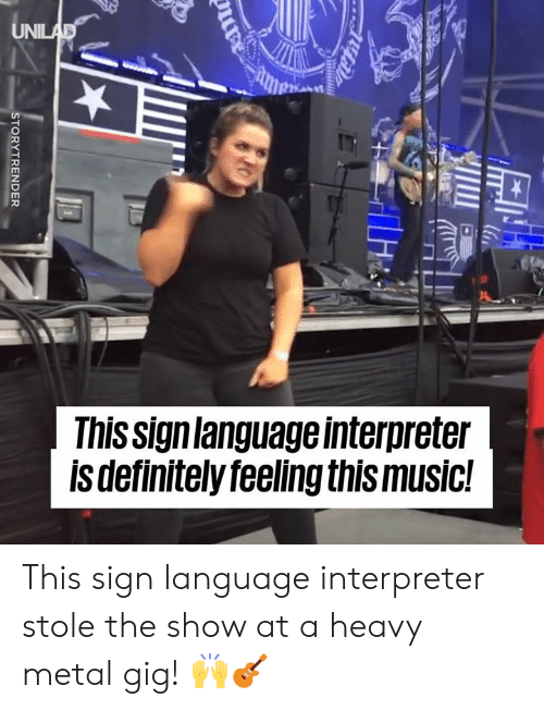 heavy metal: This signlanguage interpreter  ls definitelyfeeling this music! This sign language interpreter stole the show at a heavy metal gig! 🙌🎸