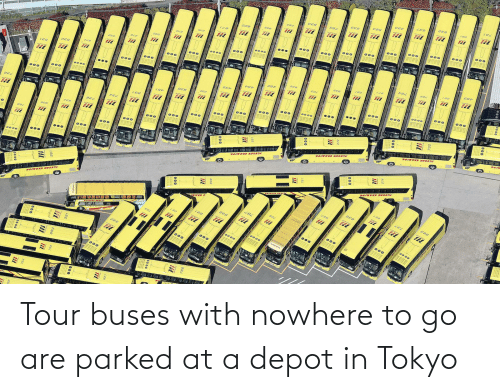 Depot: Tour buses with nowhere to go are parked at a depot in Tokyo