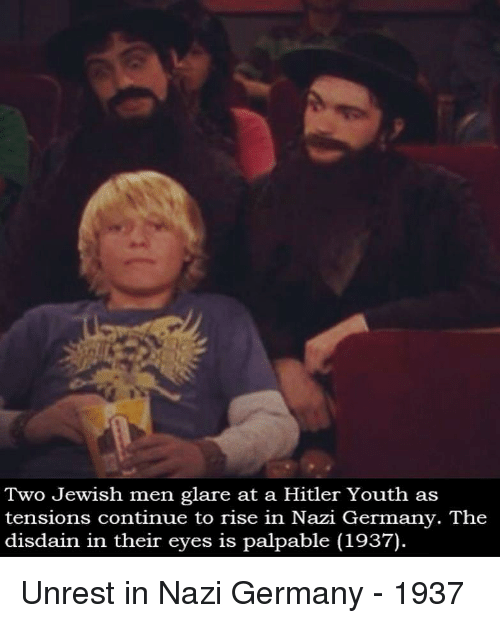 palpable: Two Jewish men glare at a Hitler Youth as  tensions continue to rise in Nazi Germany. The  disdain in their eyes is palpable (1937) Unrest in Nazi Germany - 1937