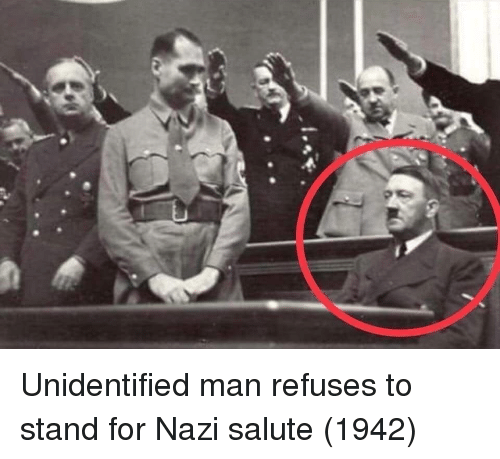 Salute: Unidentified man refuses to stand for Nazi salute (1942)