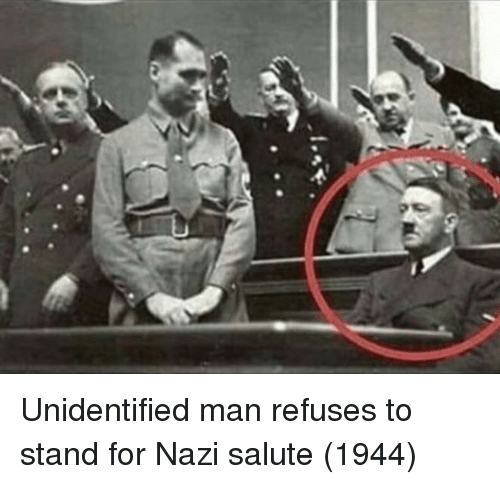 Salute: Unidentified man refuses to stand for Nazi salute (1944)