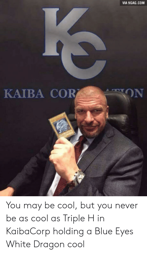 white dragon: VIA 9GAG.COM  KAIBA COR  ON You may be cool, but you never be as cool as Triple H in KaibaCorp holding a Blue Eyes White Dragon cool