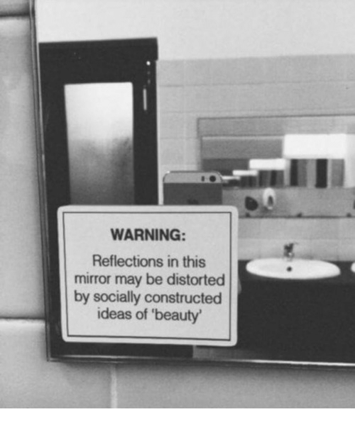 distorted: WARNING  Reflections in this  mirror may be distorted  by socially constructed  ideas of 'beauty